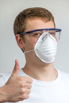 man wearing a dust mask and safety glasses