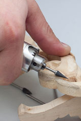 carving wood with a handheld power tool