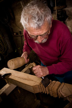 woodcarver using a wood clamp